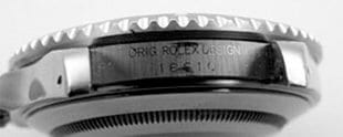 The engraving between the lugs of a GENUINE Rolex Submariner.