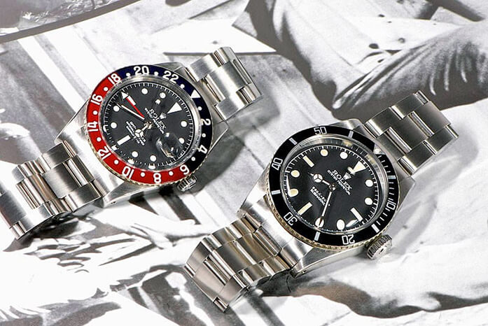 """The """"Goldfinger"""" models: Rolex GMT, reference 6542 (The Pussy), and Rolex Submariner, reference 6538 (The James)"""
