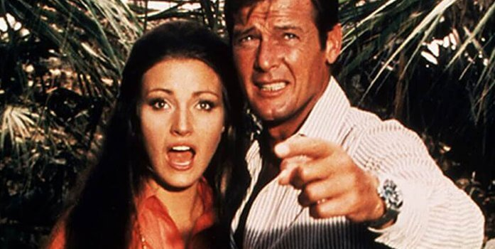 """Roger Moore & Jane Seymour in """"Live and Let Die"""". Bond's wrist watch: Rolex Submariner, reference 5513"""