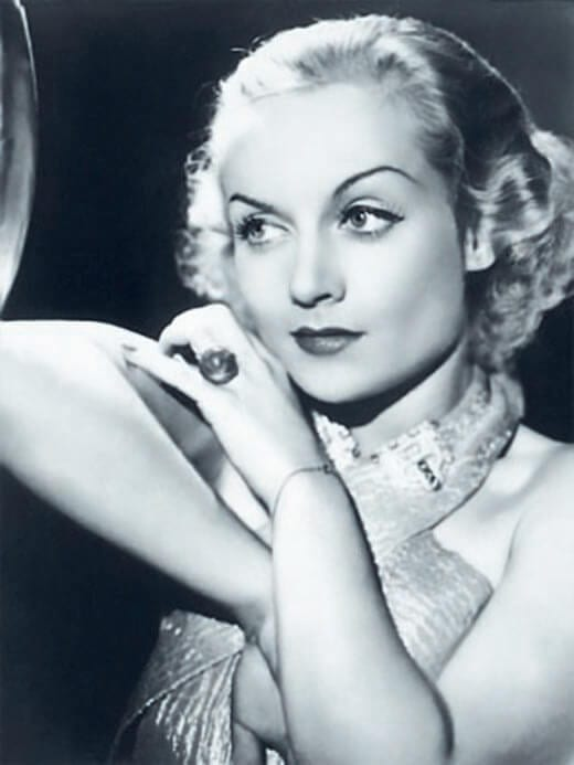 Carole Lombard wearing her star sapphire ring, ©Corbis