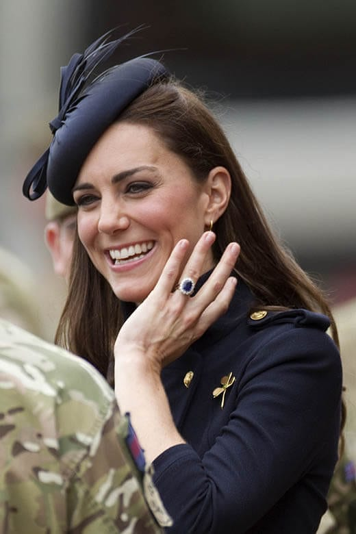 Kate Middleton wearing blue sapphire and diamonds engagement ring.