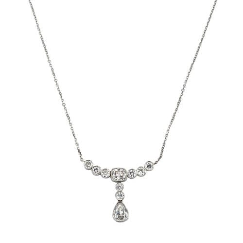 This platinum necklace featuring an old mine cut pear shaped diamond was created using a diamond from an engagement ring.