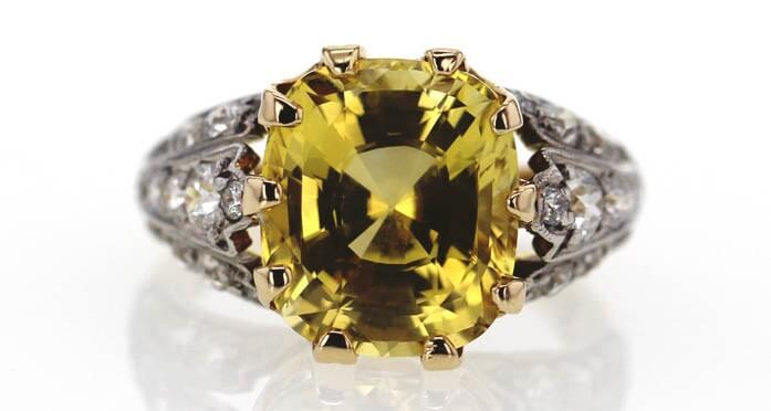 Yellow diamond cushion cut solitaire ring sold at Worthy.