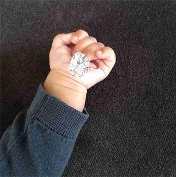 North West holds Kim's Ring