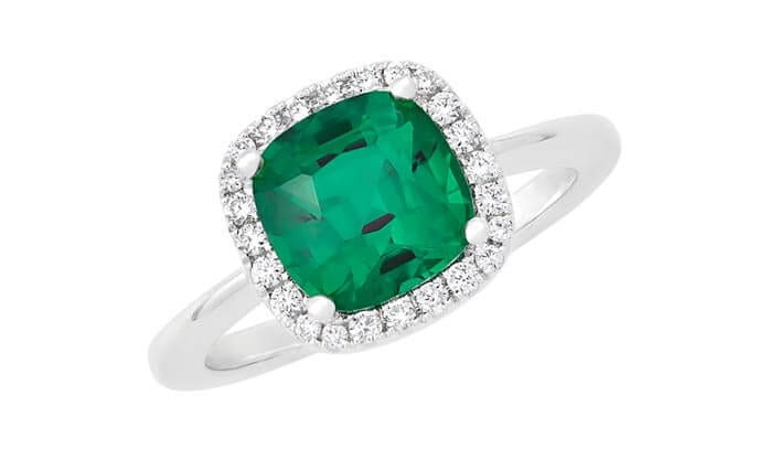 A lab-grown emerald by Chatham instead of a diamond makes this ring a symbol of a new beginning.
