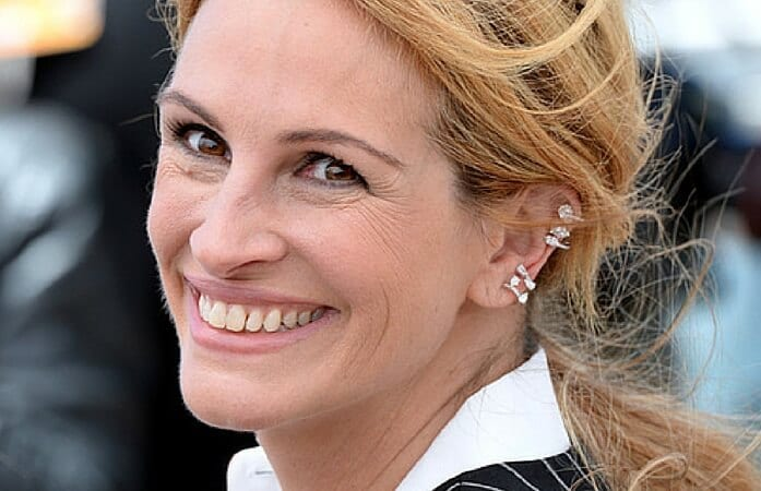 Julia Roberts wearing  Serti sur Vide ear cuffs by Repossi, at the 2016  edition of the Cannes Film Festival. Source: http://en.vogue.fr/