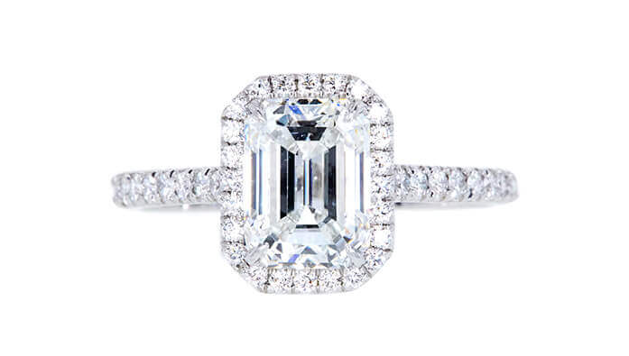 GIA 1.70 CT emerald cut halo Tiffany & Co engagement ring sold at auction for $11,066.