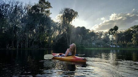 I get my glow on kayaking the Silver River as the sun is rising.