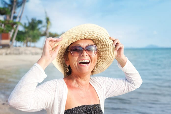 happy retired woman - financial strategies for retirement